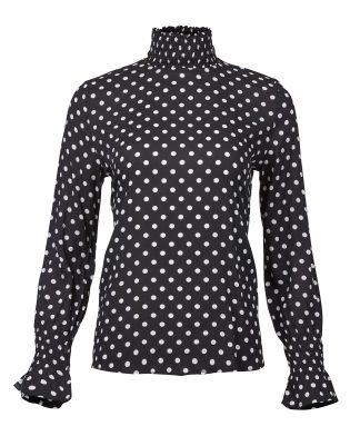 Sort bluse med hvite prikker