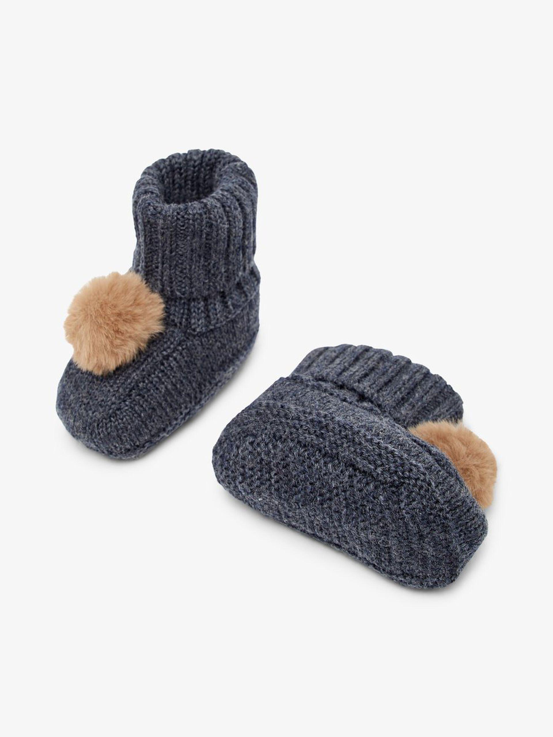 Blå slippers til baby