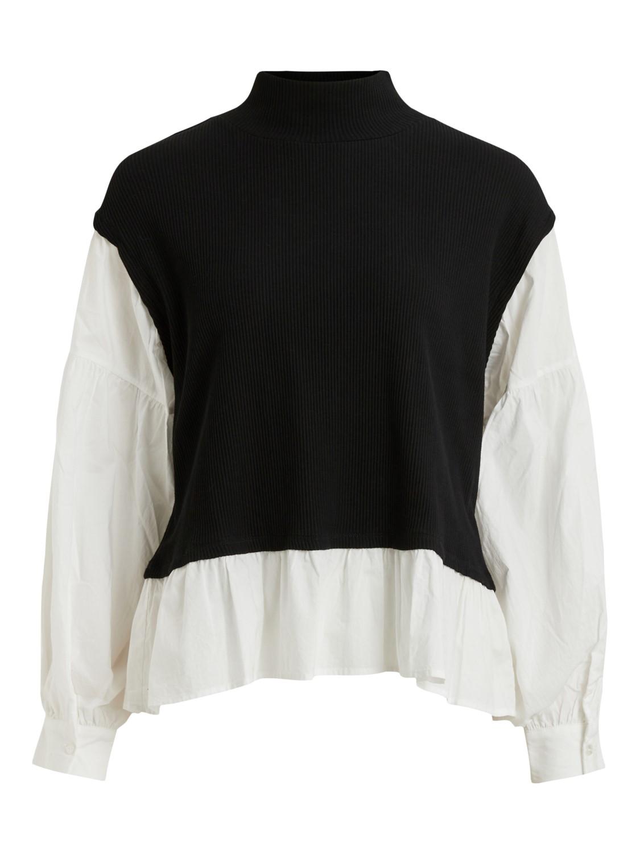 Bluse og sort vest